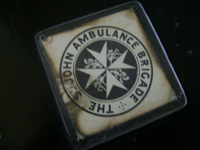 Badge on wood Ambulance First Aid Box-c1950s.jpg