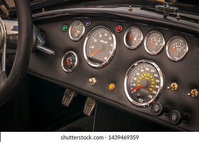 dashboard-gauges-classic-car-260nw-1439469359.jpg